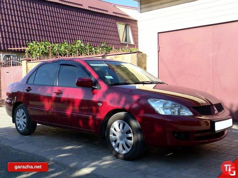 10 Фото Mitsubishi Lancer, 2008.  100 л.с. красный. передний привод. бензин.  Топливо.  68 тыс.км. все фото. автомат.
