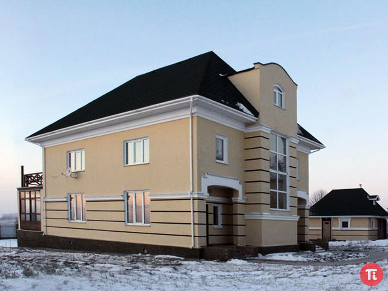 Отделка фасада домов деревом фото