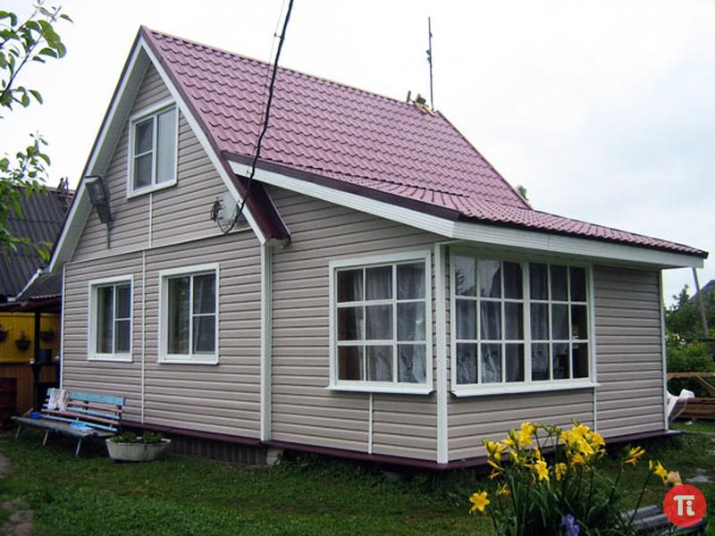 Облицовка садового домика сайдингом